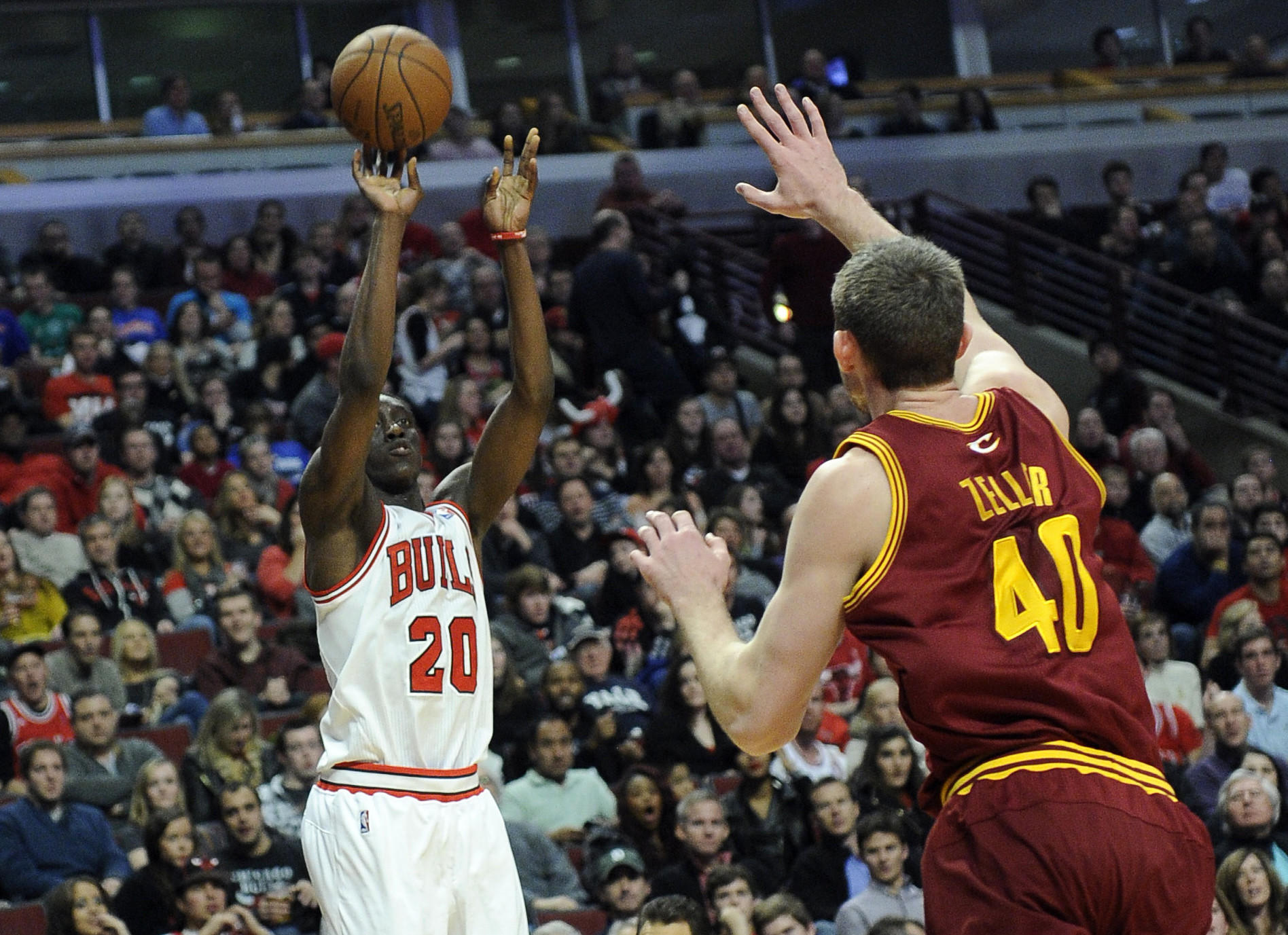 Tony Snell shoots over the Cavaliers' Tyler Zeller during the second half.