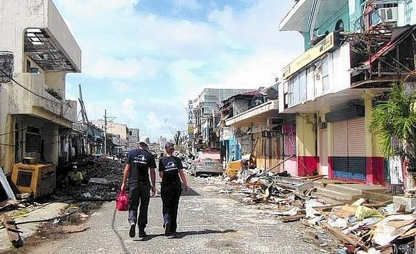 Dr. Springer Browne and Dr. Helle Hydeskov from World Vets Disaster Response Team make their way through the city of Guiuan, Eastern Samar Philippines, where they were part of a team providing veterinary care and animal welfare assessments.