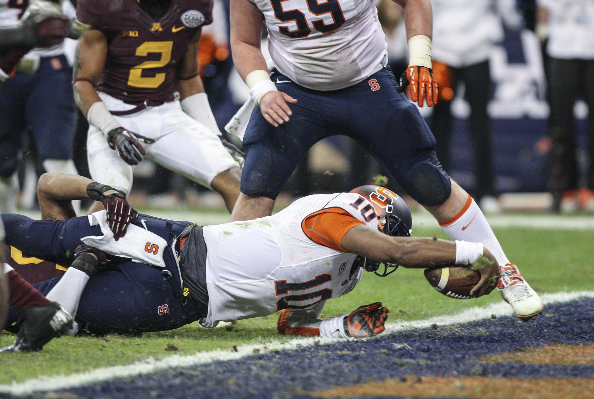 Syracuse quarterback Terrel Hunt dives for a touchdown during the third quarter of the Texas Bowl against Minnesota at Reliant Stadium.