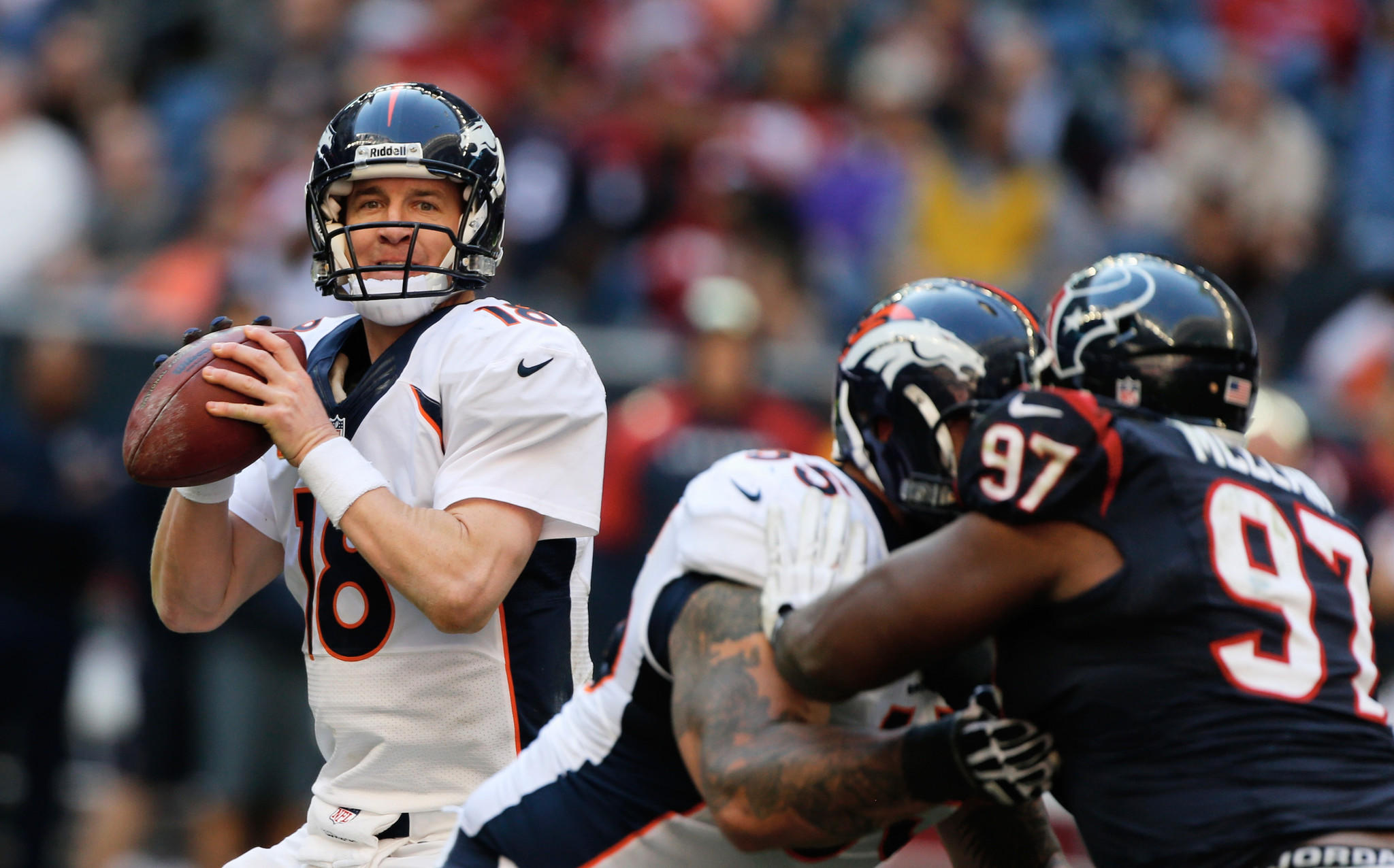 Peyton Manning of the Denver Broncos drops back to pass during the second half of the game against the Houston Texans at Reliant Stadium on Dec. 22 in Houston, Texas.