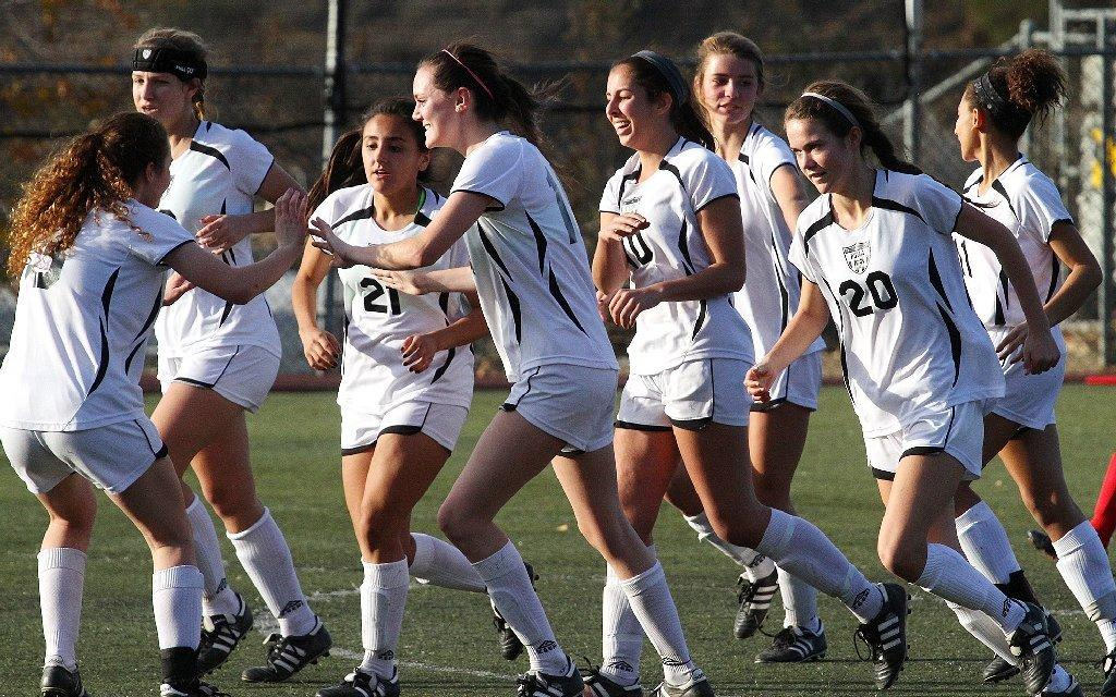 The Flintridge Sacred Heart Academy soccer team celebrates it first goal to tie its match against La Salle in the Los Tacos Holiday Festival Tournament at the Glendale Sports Complex on Friday. The Tologs won, 3-2. (Tim Berger/Staff Photographer)