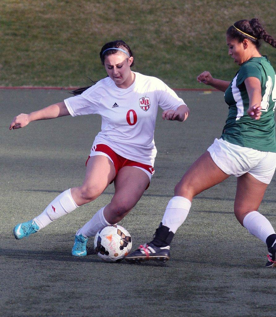 Burroughs High's Danielle Tilton attempts to cut with the ball against Royal's Jackie Morales in the Los Tacos Holiday Festival Tournament at the Glendale Sports Complex on Friday. (Tim Berger/Staff Photographer)