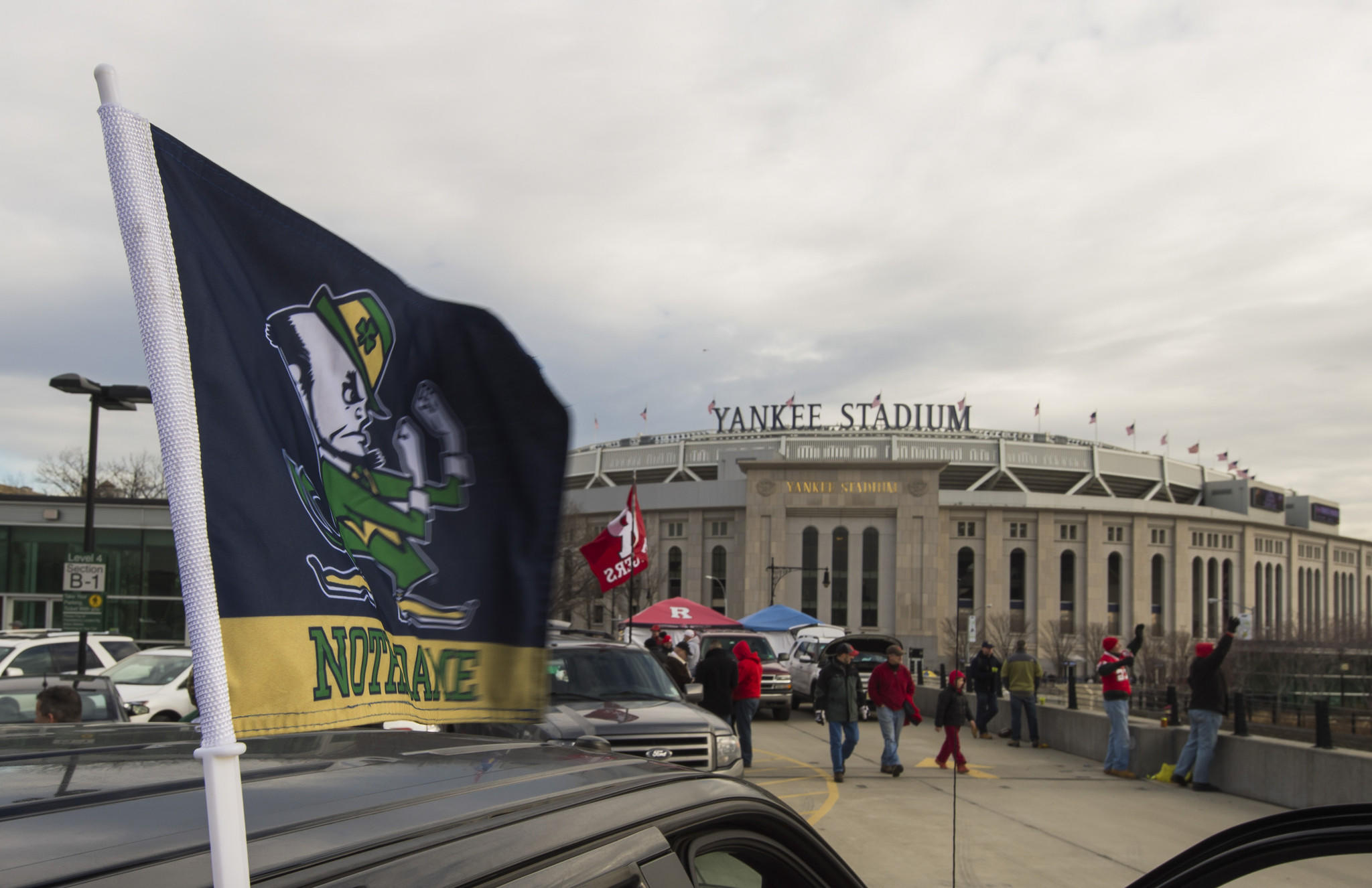 Fans tailgate outside Yankee Stadium before the Pinstripe Bowl game between the Notre Dame Fighting Irish and the Rutgers Scarlet Knights.