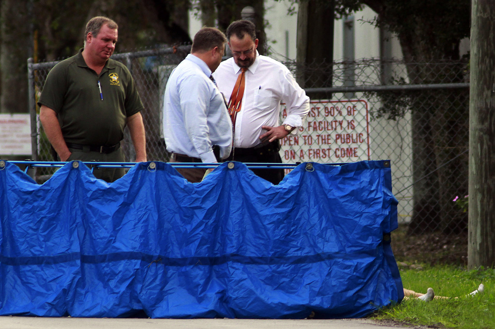 Broward sheriff's homicide detectives investigate after a female body was found on the road at 3100 State Road 84.