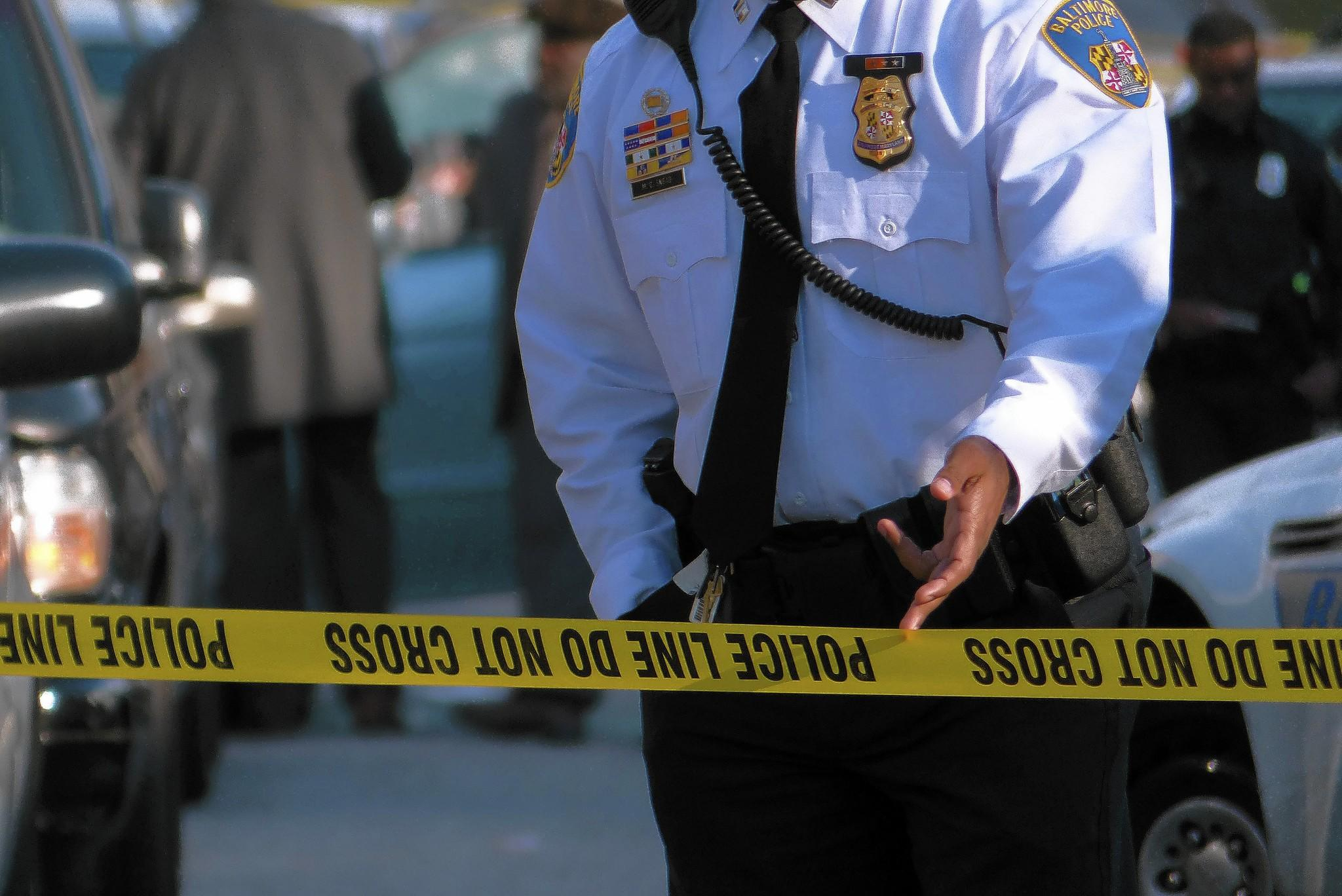Police inspect a crime scene on E. 29th Street, east of Kirk Av, where a shooting occurred Thursday, Dec. 19, 2013.