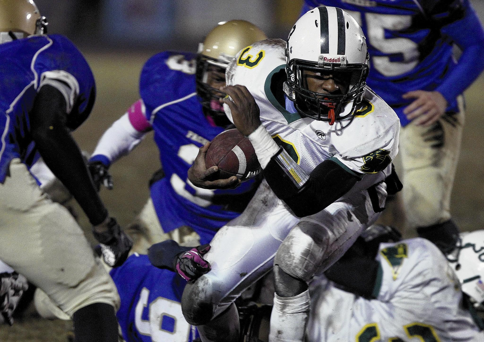Rob Ostermaier/Daily Press file photo Bruton's Richard Taylor picks his way through the Smithfield defense in November at Smithfield.