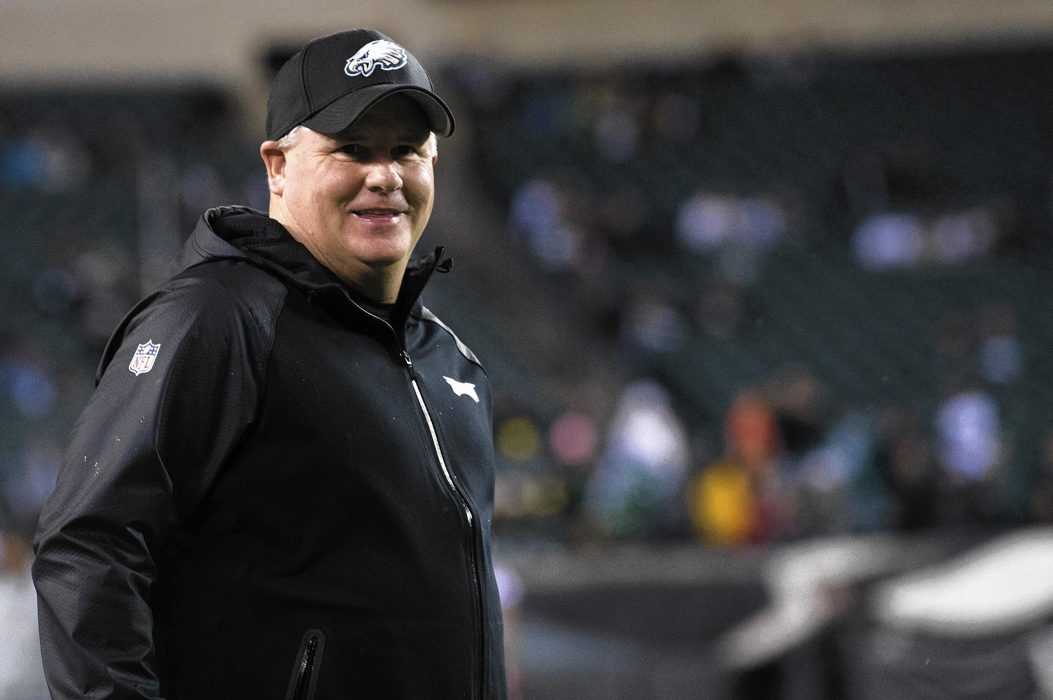 Dec 22, 2013; Philadelphia, PA, USA; Philadelphia Eagles head coach Chip Kelly watches his team during pre game at Lincoln Financial Field.