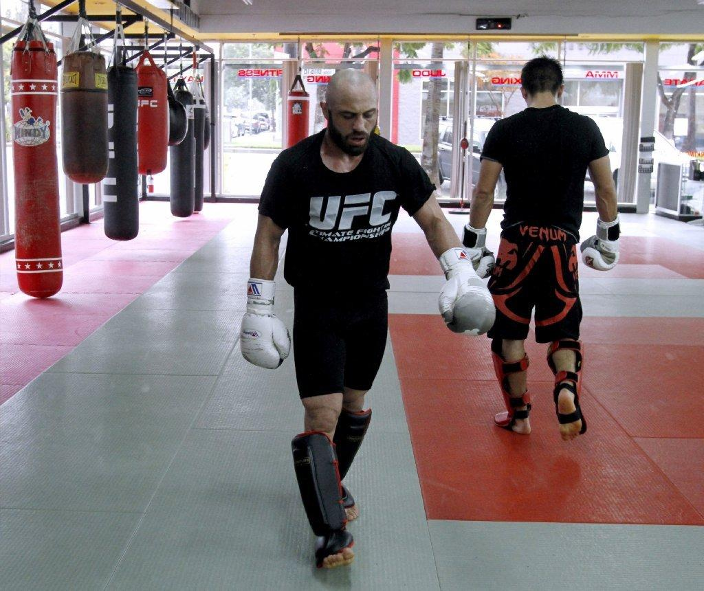 Manny Gamburyan, left, seen here training last week at the Glendale Fighting Club, lost by a 29-28 three-round unanimous decision at UFC 168 on Saturday in Las Vegas. (Raul Roa/Staff Photographer)