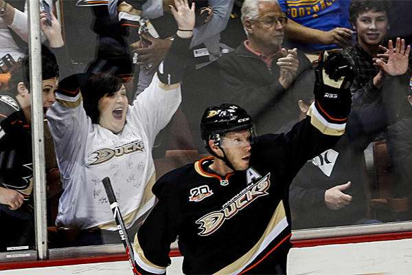 Ducks center Saku Koivu celebrates after his first-period goal against Phoenix on Saturday night. He also scored in overtime to give the Ducks a 3-2 victory.
