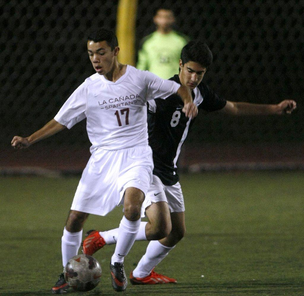 La Caada High's Keivan Meshkat, left, tries to keep the ball away from Glendale's Matthew Shafrazian, right, in the La Caada Tournament on Saturday. The Spartans won, 2-1. (Raul Roa/Staff Photographer)