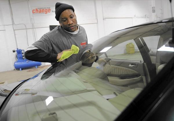 Lamont Jones-Bey is one of four paid interns detailing cars for Vehicles for Change through the Academy for Automotive Careers. They completed a four week auto detailing course and recently graduated. The vehicles will go to low-income families.
