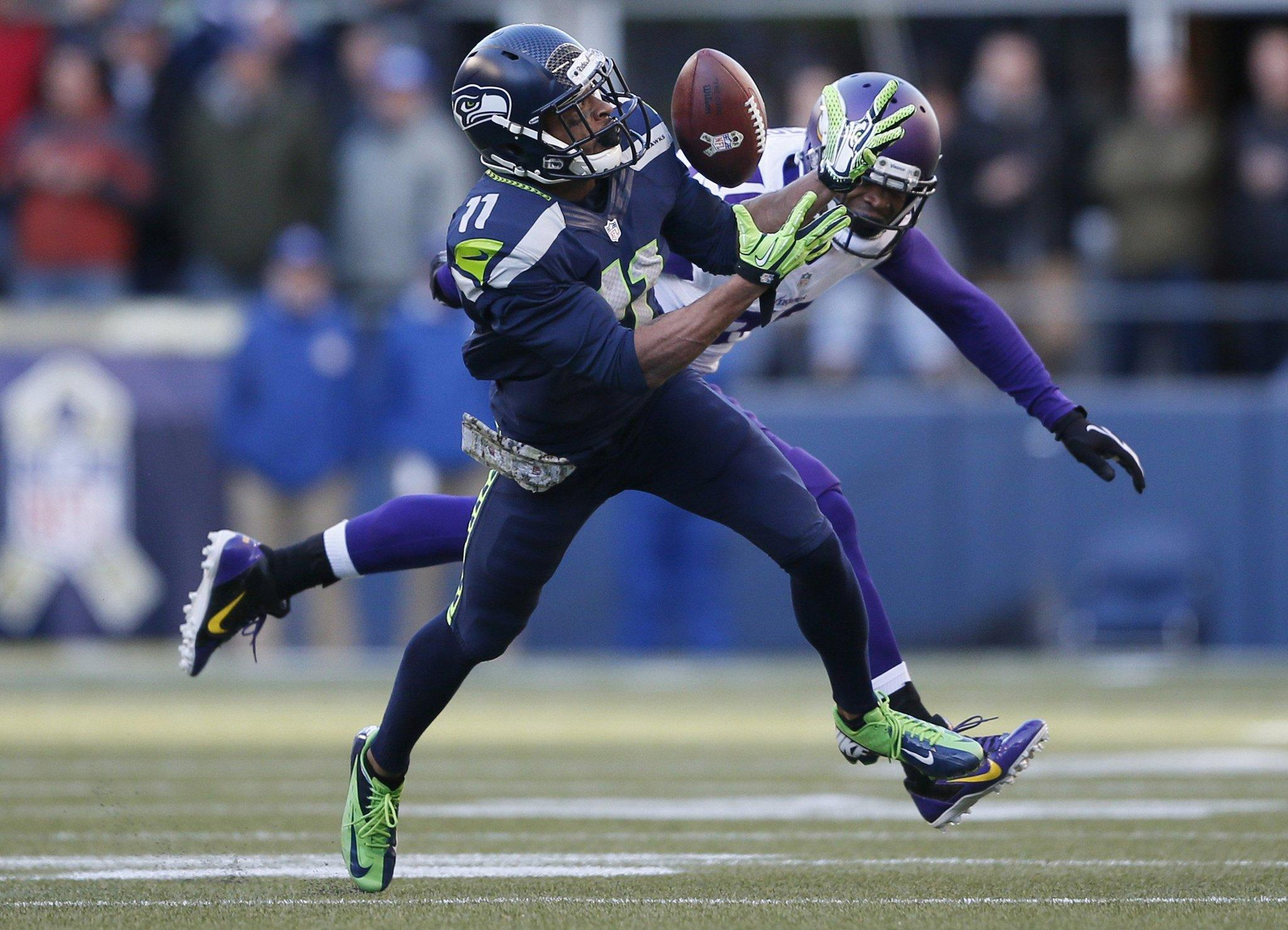 Percy Harvin of the Seattle Seahawks pulls down a catch against Chris Cook (20) of the Minnesota Vikings. It was his only reception of the season.