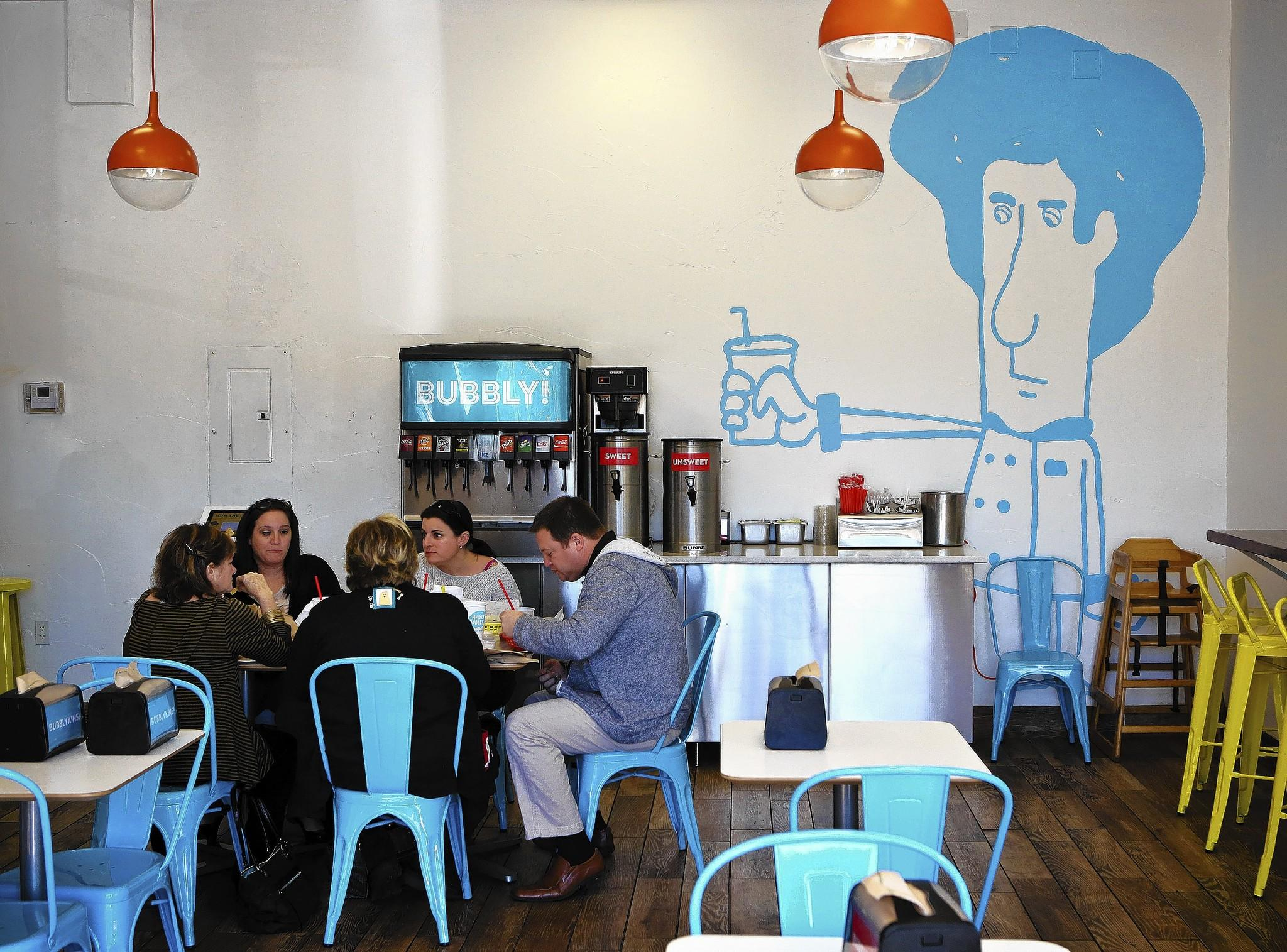 Customers eat inside of Hubbly Bubbly Falafel Shop on Edgewater Drive in Orlando on December 17, 2013.