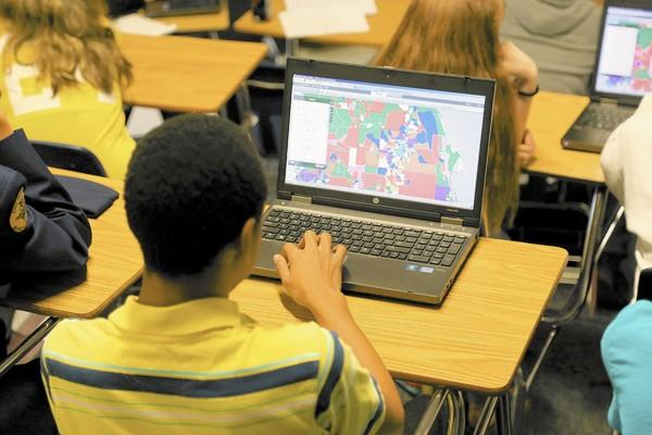 "Eustis High School students learn about computer-based mapping, known as ""geospatial information systems,"" or GIS."