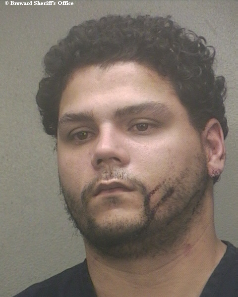 Raul Armando Serrano is charged in the murder of a woman found partially clothed off State Road 84 in Dania Beach.