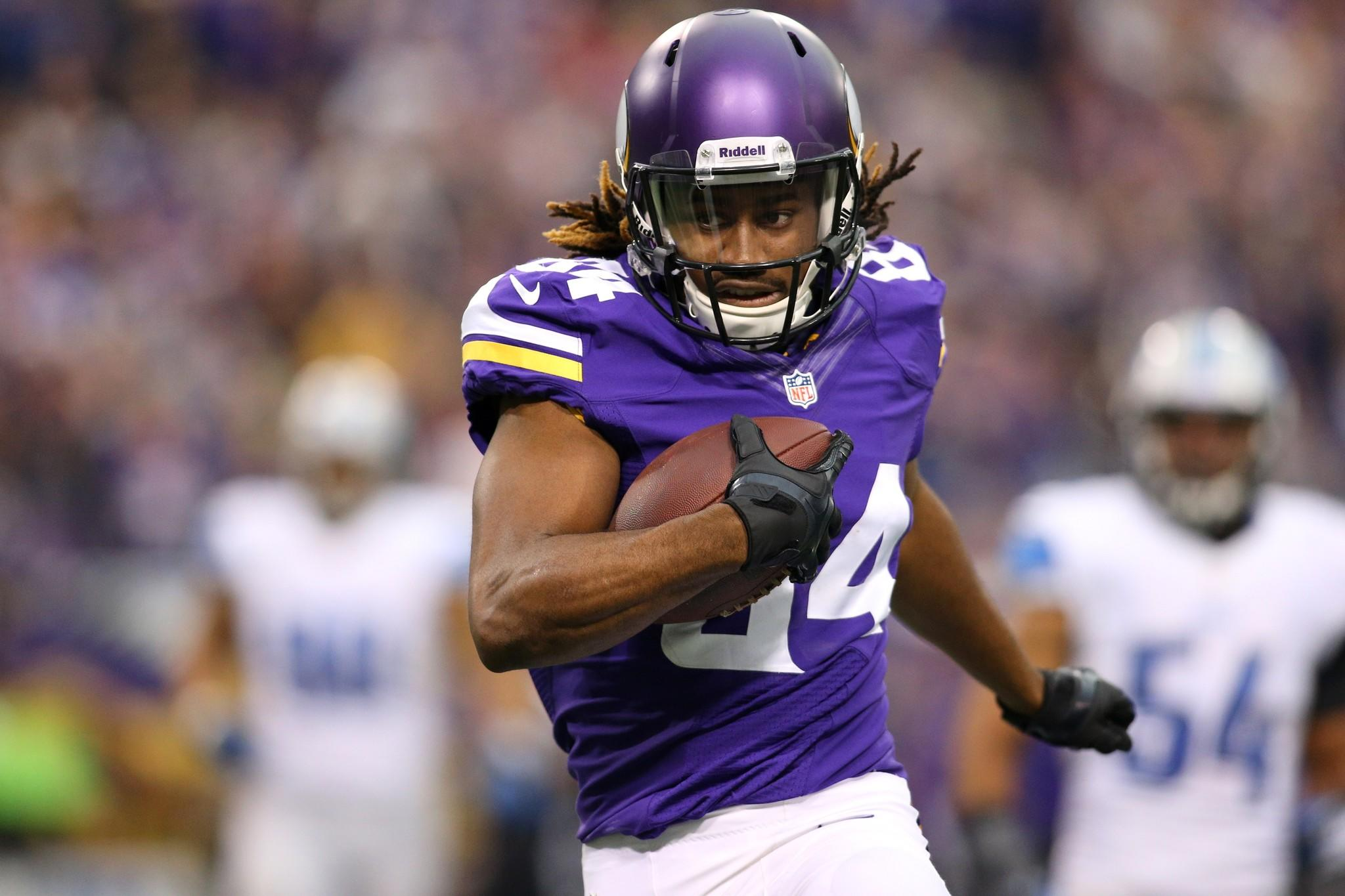 Cordarrelle Patterson #84 of the Minnesota Vikings carries the ball 50 yards for a touchdown against the Detroit Lions.