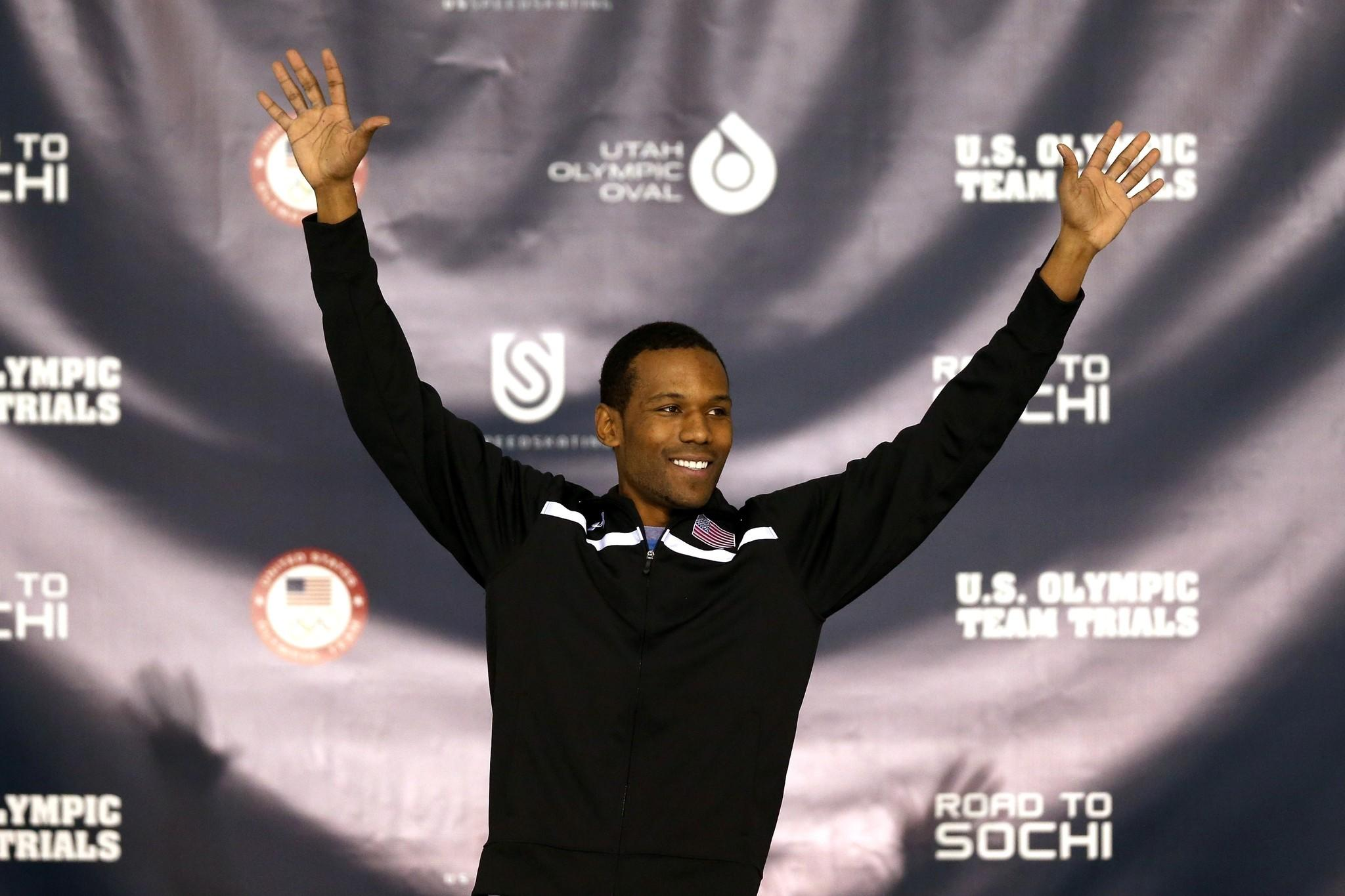 Shani Davis celebrates on the medals podium after winning the men's 1,000 meter during the U.S. Speed Skating Long Track Olympic Trials at the Utah Olympic Oval.