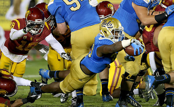 UCLA running back Myles Jack dives into the end zone for a touchdown during the Bruins' 35-14 win over USC on Nov. 30. Assuming linebacker and running back roles for the Bruins has made Jack a star -- at least in the Bruins' locker room and on the UCLA campus.