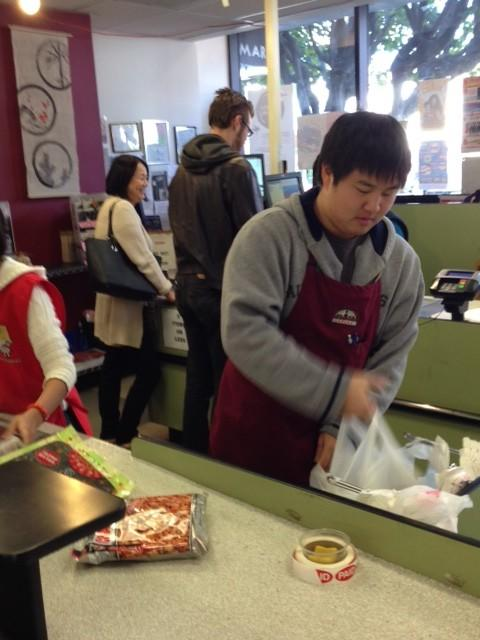 Nicholas Ogino bags groceries at Marukai Market in Little Tokyo, which is posting signs about the coming change.