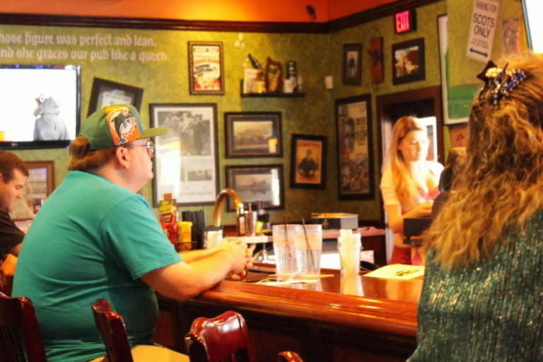 Ian Kennedy, 36, of Avalon Park watches the Dolphins vs. Jets game at the Tilted Kilt on University Boulevard.