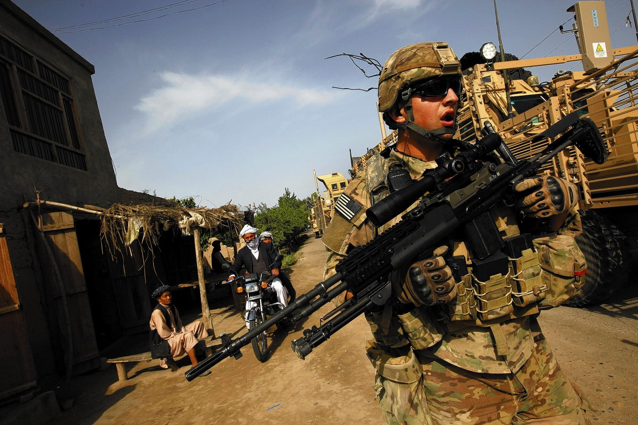 A member of a U.S. military route-clearance team works in Kunduz province in April. Security conditions in Afghanistan probably will worsen regardless of whether the U.S. keeps troops in the country, according to a new, classified assessment by U.S. intelligence agencies.
