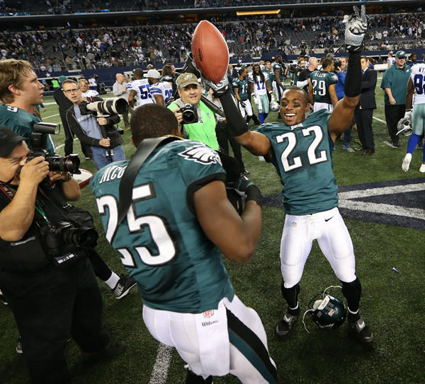 Philadelphia Eagles cornerback Brandon Boykin celebrates a victory with running back LeSean McCoy against the Dallas Cowboys at AT&T Stadium on Sunday. The Eagles defeated the Cowboys 24-22 to win the NFC East title and a playoff berth.
