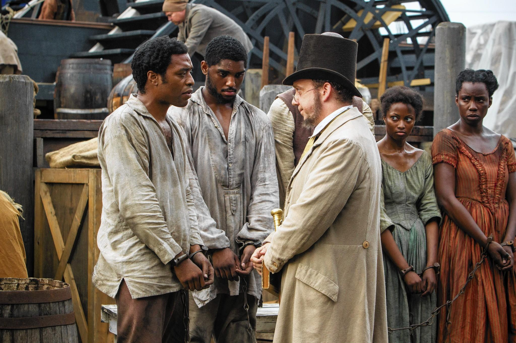 "The antebellum drama ""12 Years a Slave,"" with Chiwetel Ejiofor, left, and Paul Giamatti, right, was part of a slate of 2013 films that critics regard as one of the best in a decade."