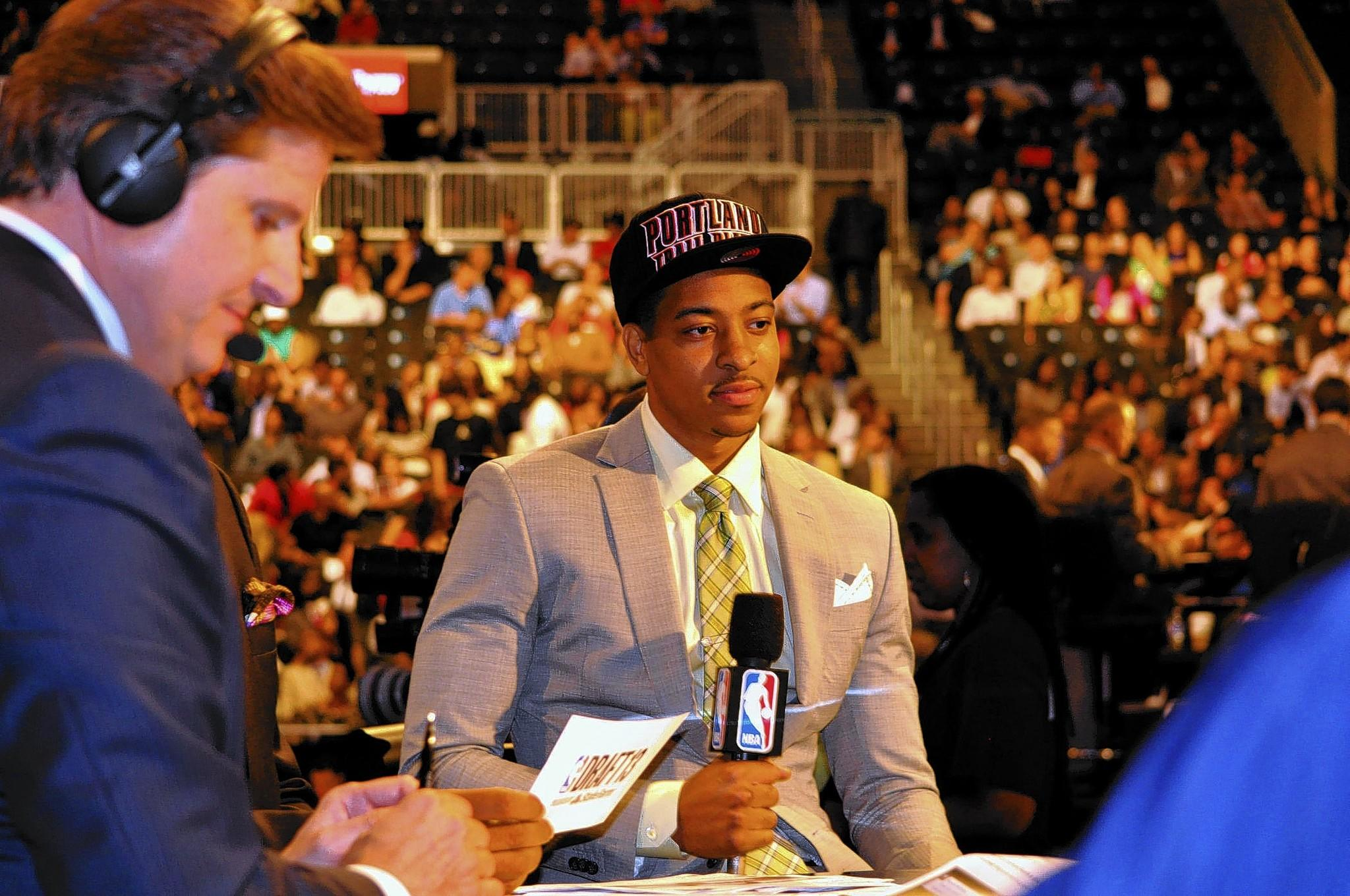 Lehigh grad C.J. McCollum waits to do an interview after he was drafted 10th by the Portland Trailblazers last June.