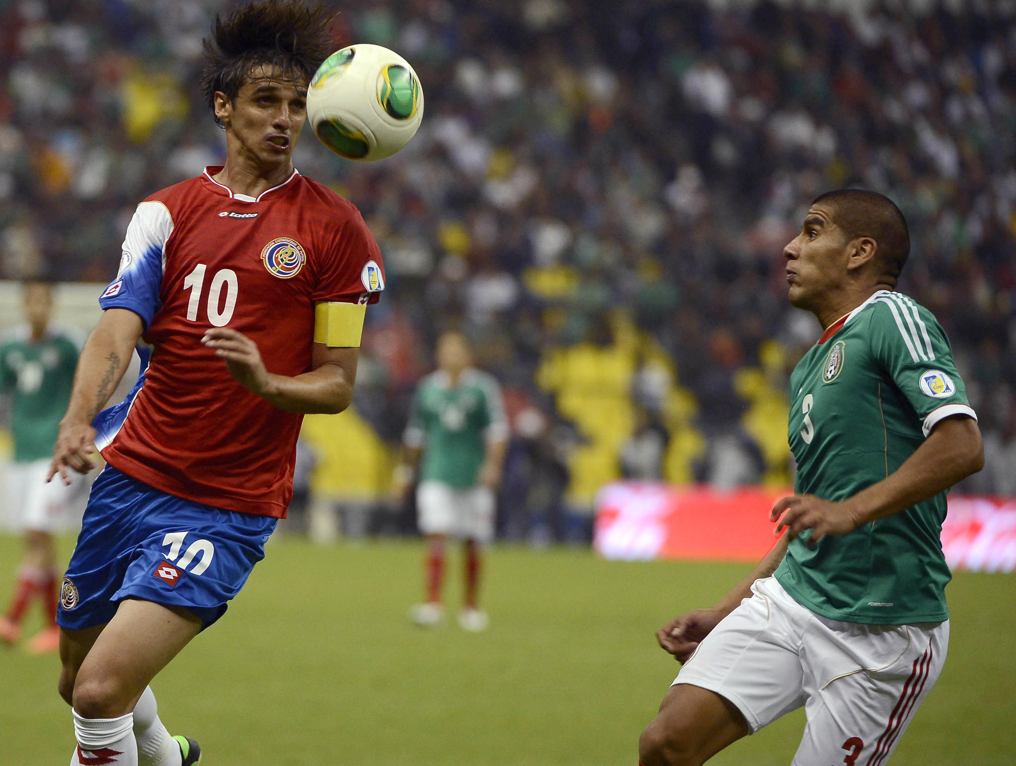 Costa Rica's player Bryan Ruiz (L) tries to control the ball next to Mexico's Carlos Salcido during their FIFA World Cup Brazil 2014 Concacaf qualifier match at the Azteca Stadium in Mexico City on June 11, 2013.