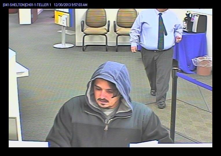 A surveillance image released of a person suspected of robbing a Webster bank in Shelton.