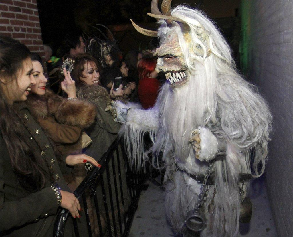 Party-goers have fun with a Krumpus during Christmas-themed Rammstein tribute Krampus Rumpus at the Complex in Glendale.