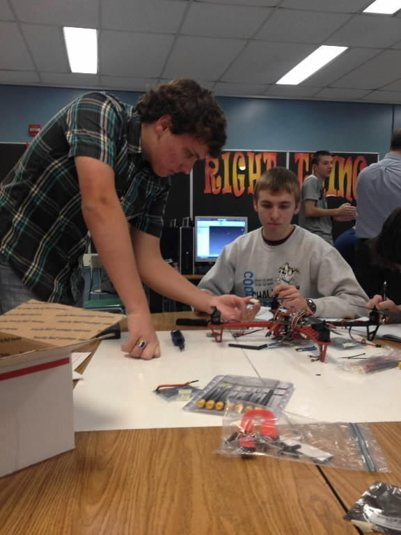 South River High School junior Chris Mylod, 16, of Riva and senior Zachary Chester look over a drone model they are assembling.