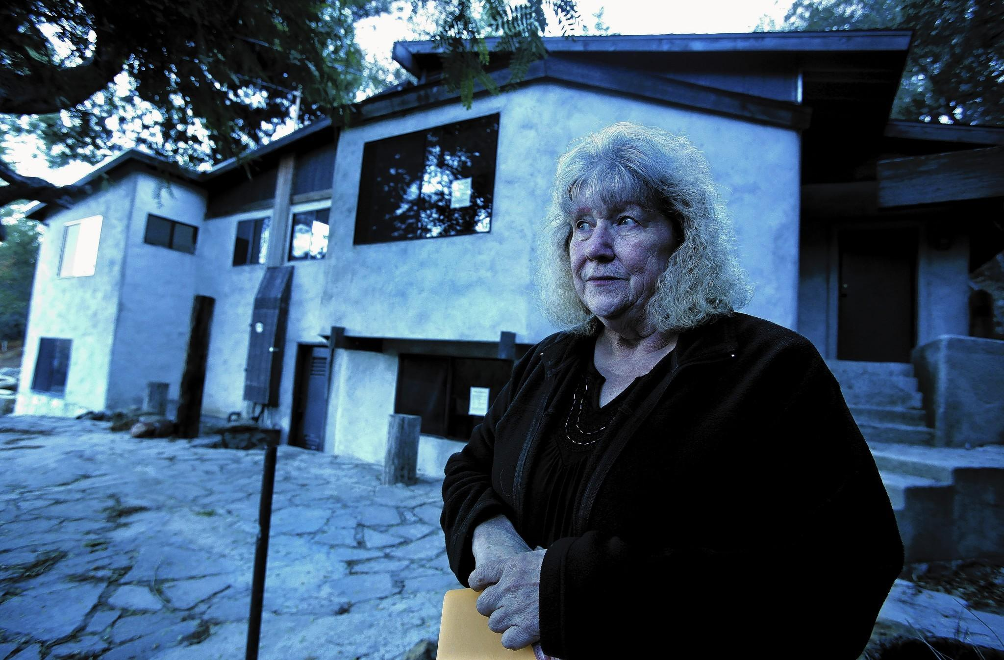 Joanne Finazzo, 67, had to move out of her home after Calabasas slapped the property with code violations and it ended up in foreclosure. The bank is expected to raze it. She and other owners of older homes say they think they're being unfairly targeted.