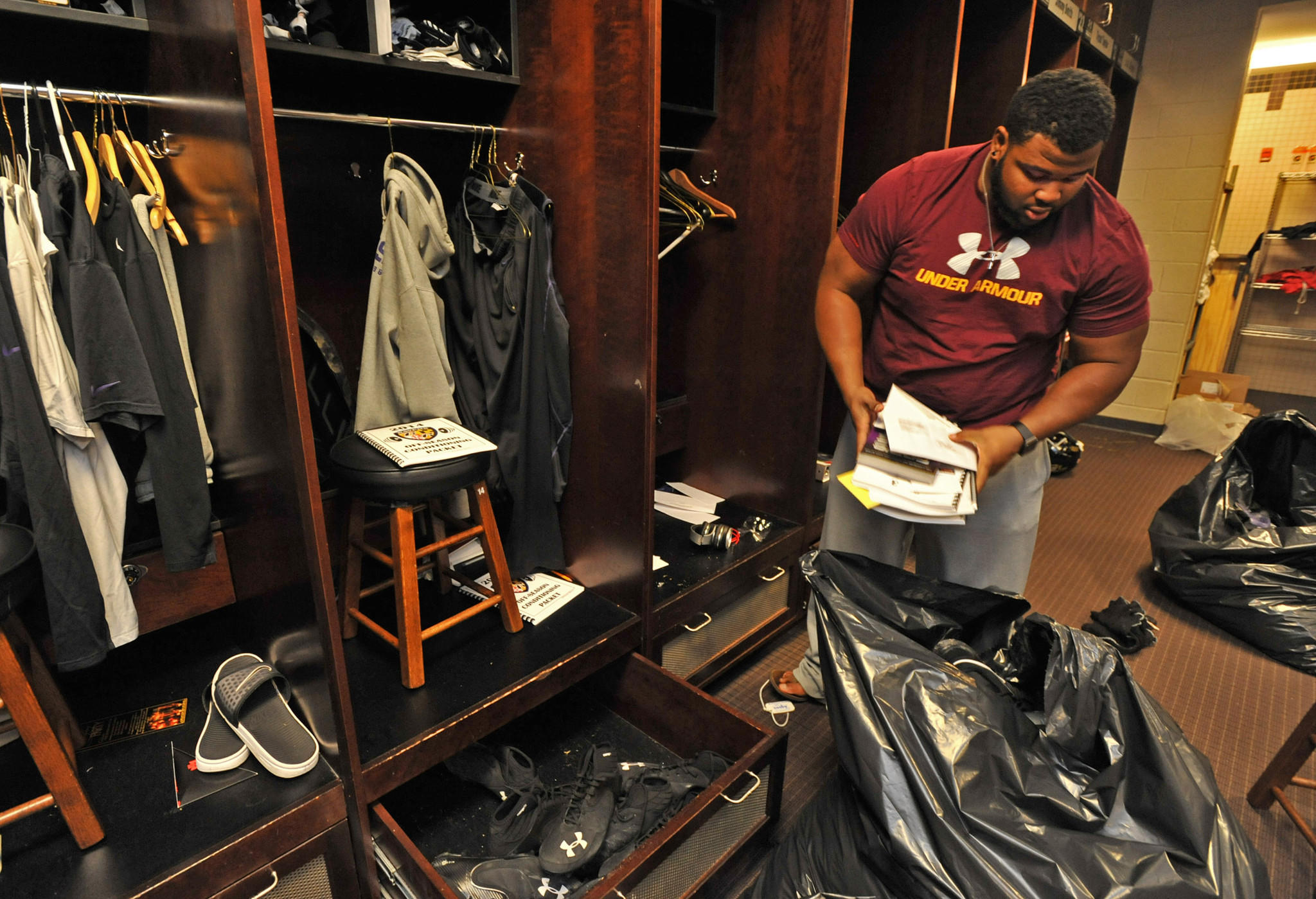 Brandon Williams packs up his belongings the day after the Ravens' regular season ended in a loss to the Cincinnati Bengals.