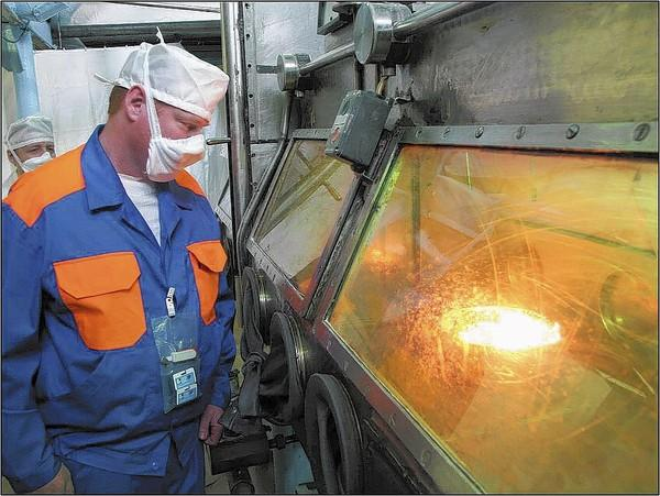Robert Elwood, of Tennessee-based Nuclear Consultants and Engineers, watches the opening phase of turning weapons-grade nuclear material into fuel for nuclear power plants in U.S. at a chemical plant in Seversk, Russia.