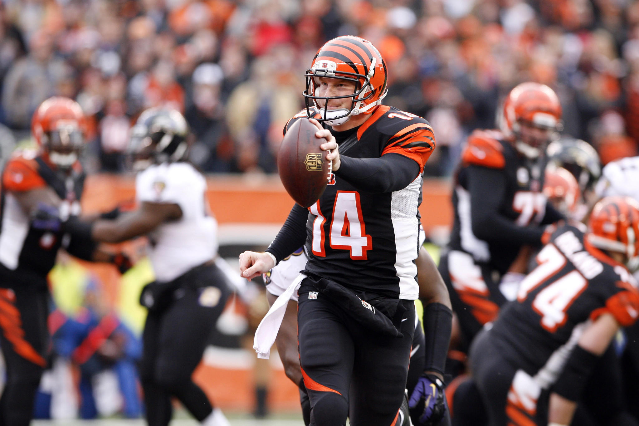 Cincinnati Bengals quarterback Andy Dalton (14) runs the ball for a touchdown against the Baltimore Ravens in the fourth quarter at Paul Brown Stadium. Cincinnati defeated Baltimore 34-17.