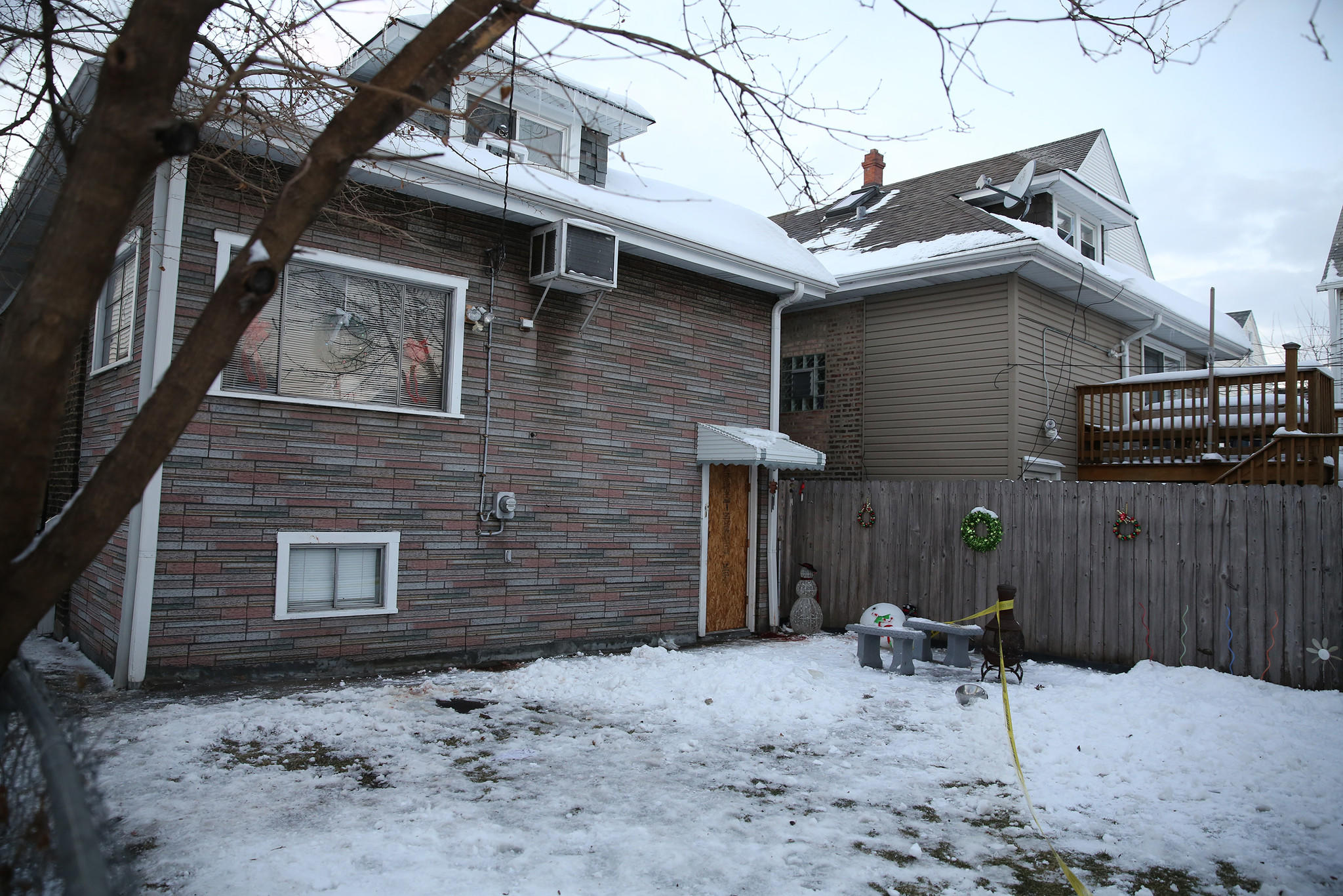 The backyard of a home in the 2400 block of Long Ave. in Chicago, where a 15-year-old girl was sexually assaulted and beaten. Blood was still present on the window frame and on the snowy ground.