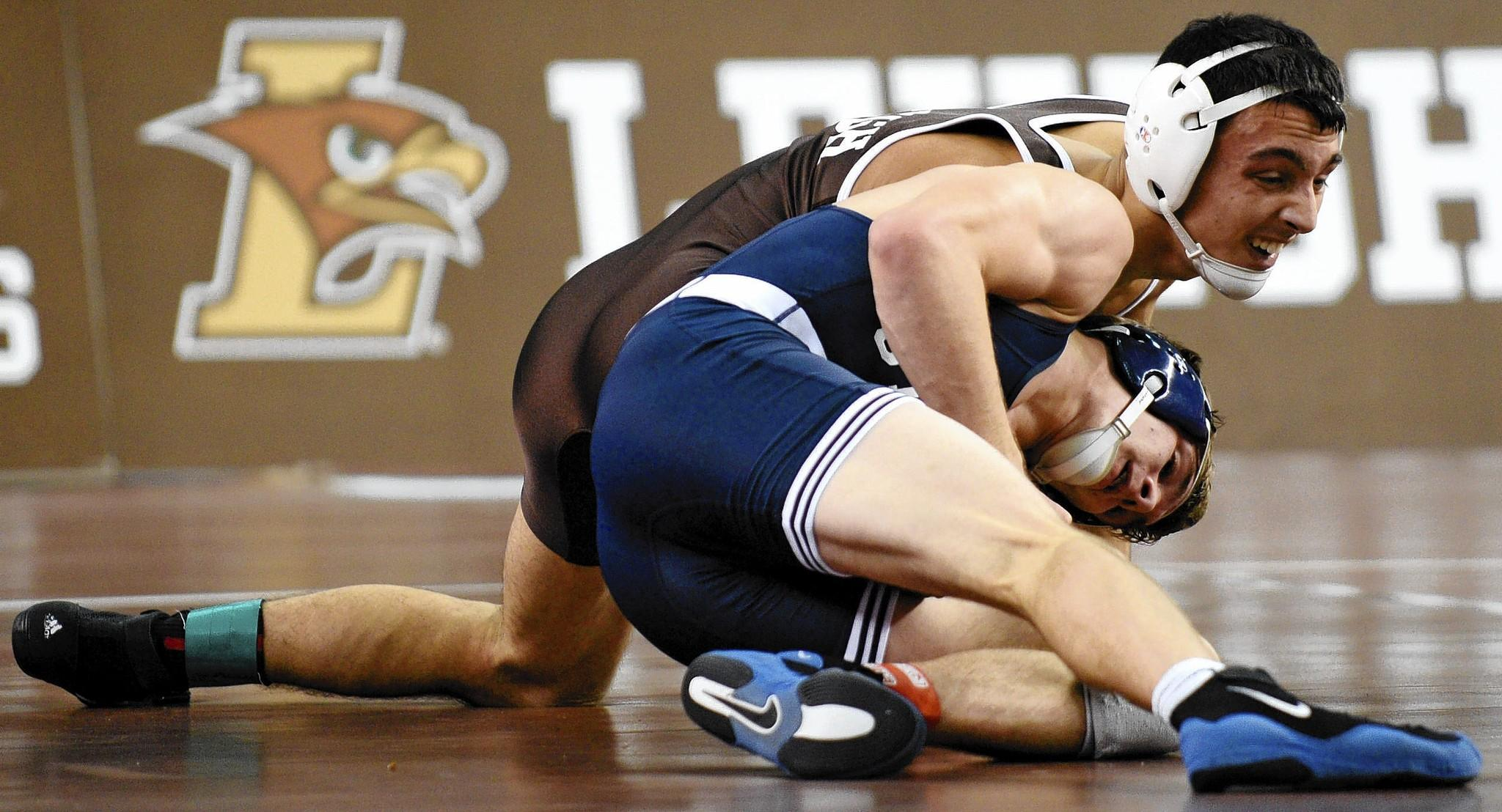 Mitch Minotti (top) became the first Lehigh freshman to win an undergraduate Midlands championship.