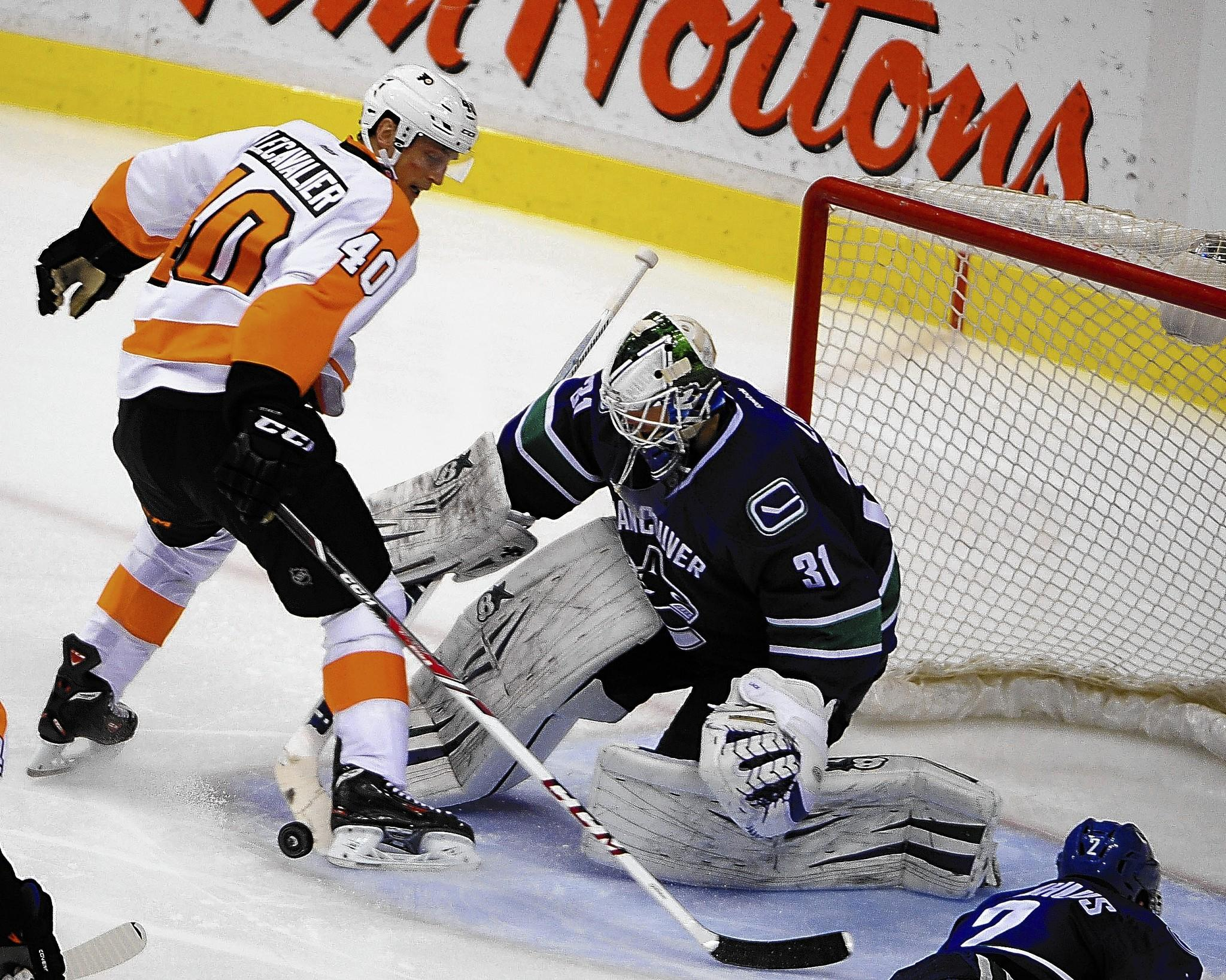 Flyers forward Vincent Lecavalier moves the puck in front of Vancouver goaltender Eddie Lack during the third period at Rogers Arena on Monday night. Philadelphia won 4-3.
