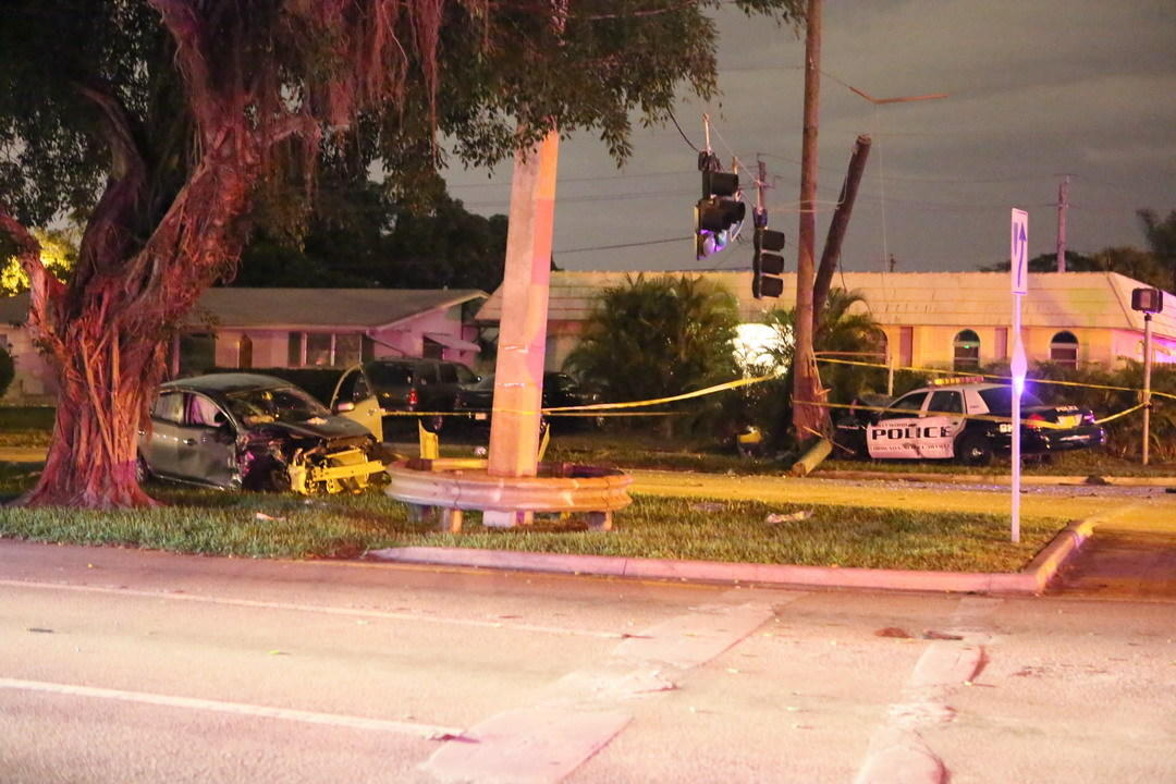 A crash involving two cars, one of them a Hollywood community service officer late Monday night, Dec. 30, 2013 left four people hurt and the intersection of North Park Road and Taft Street without functioning traffic signals.