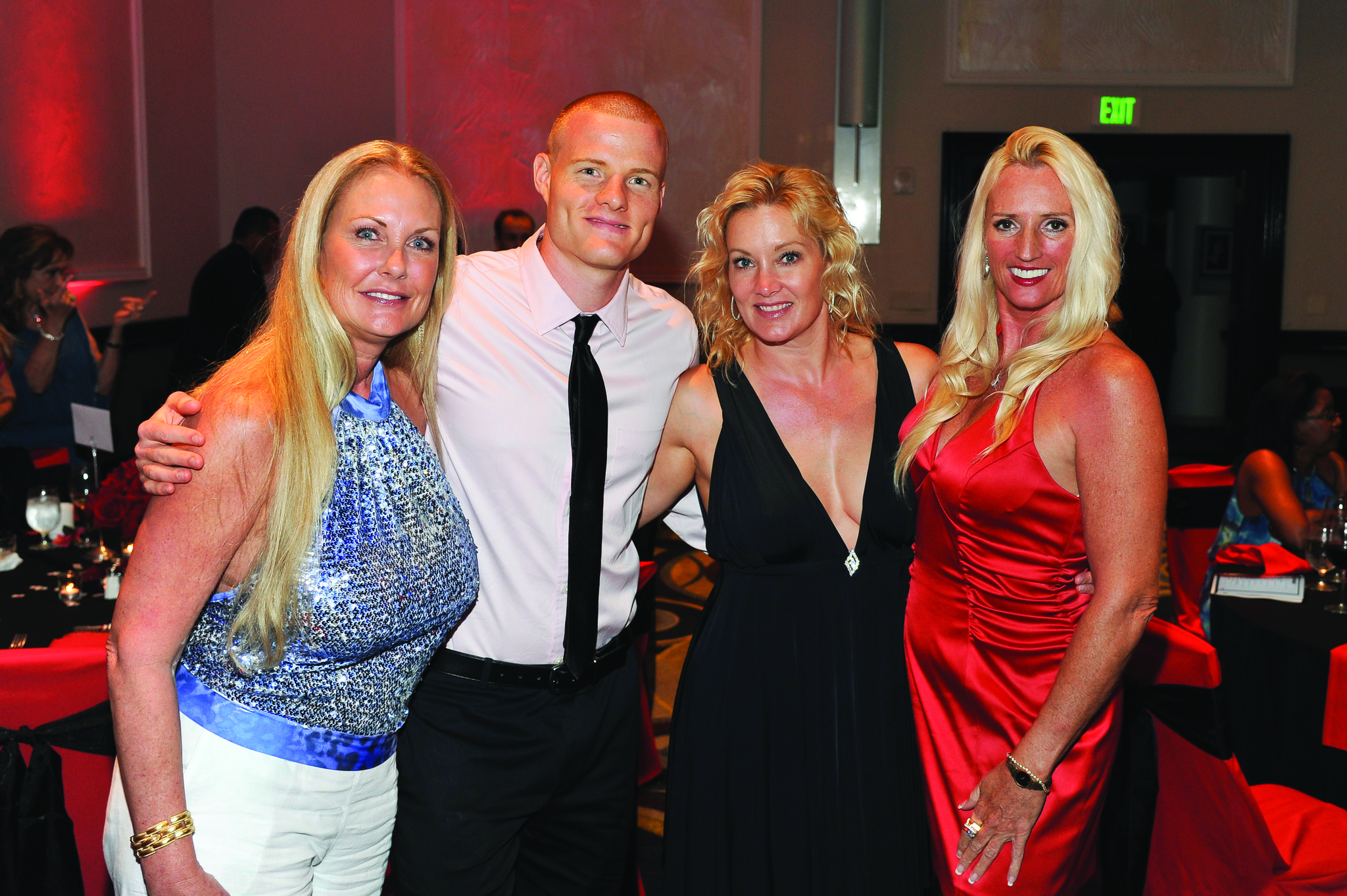"""Society Scene photos - Teresa Orr, left, Nick Murtha, Dr. Lisa Learn and Laurina Anderson attended the third annual """"Hypoglycemia Takes Center Stage Gala: Casino Royale,"""" which took place at the Hyatt Regency Pier Sixty-Six."""