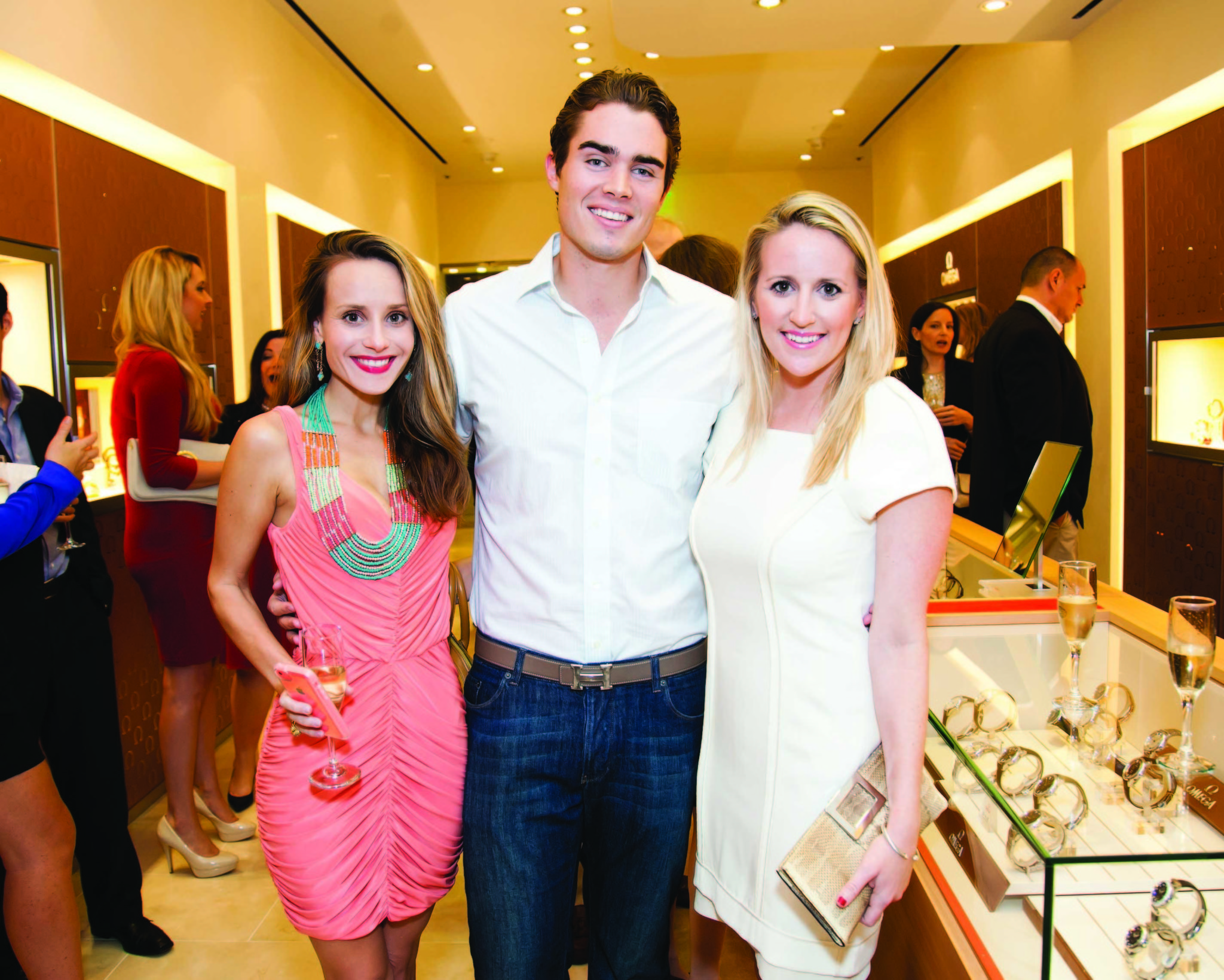 Society Scene photos - Samantha Marulli, left, Robert Murphy and Brooke Chapman Marshman were among the more than 60 members of the Young Friends of the Norton who packed OMEGA