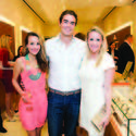 """Samantha Marulli, left, Robert Murphy and Brooke Chapman Marshman were among the more than 60 members of the Young Friends of the Norton who packed OMEGA's new boutique on Worth Avenue in Palm Beach for the group's holiday party, """"The Most Wonderful Time of the Year."""""""