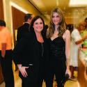 """Rebecca Jagle, left, and Katherine Lande were stylish in black for OMEGA's new boutique on Worth Avenue in Palm Beach, in honor of the Young Friends of the Norton's holiday party, """"The Most Wonderful Time of the Year."""""""