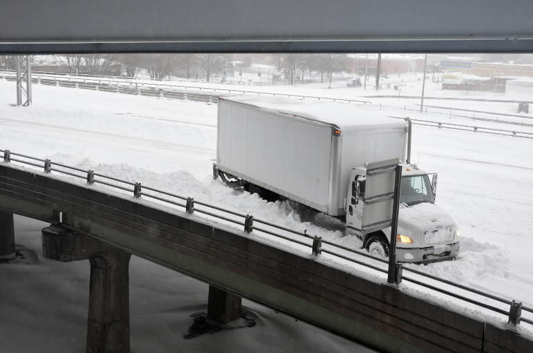 A truck gets on the exit 52 ramp on I-84 in downtown Hartford.