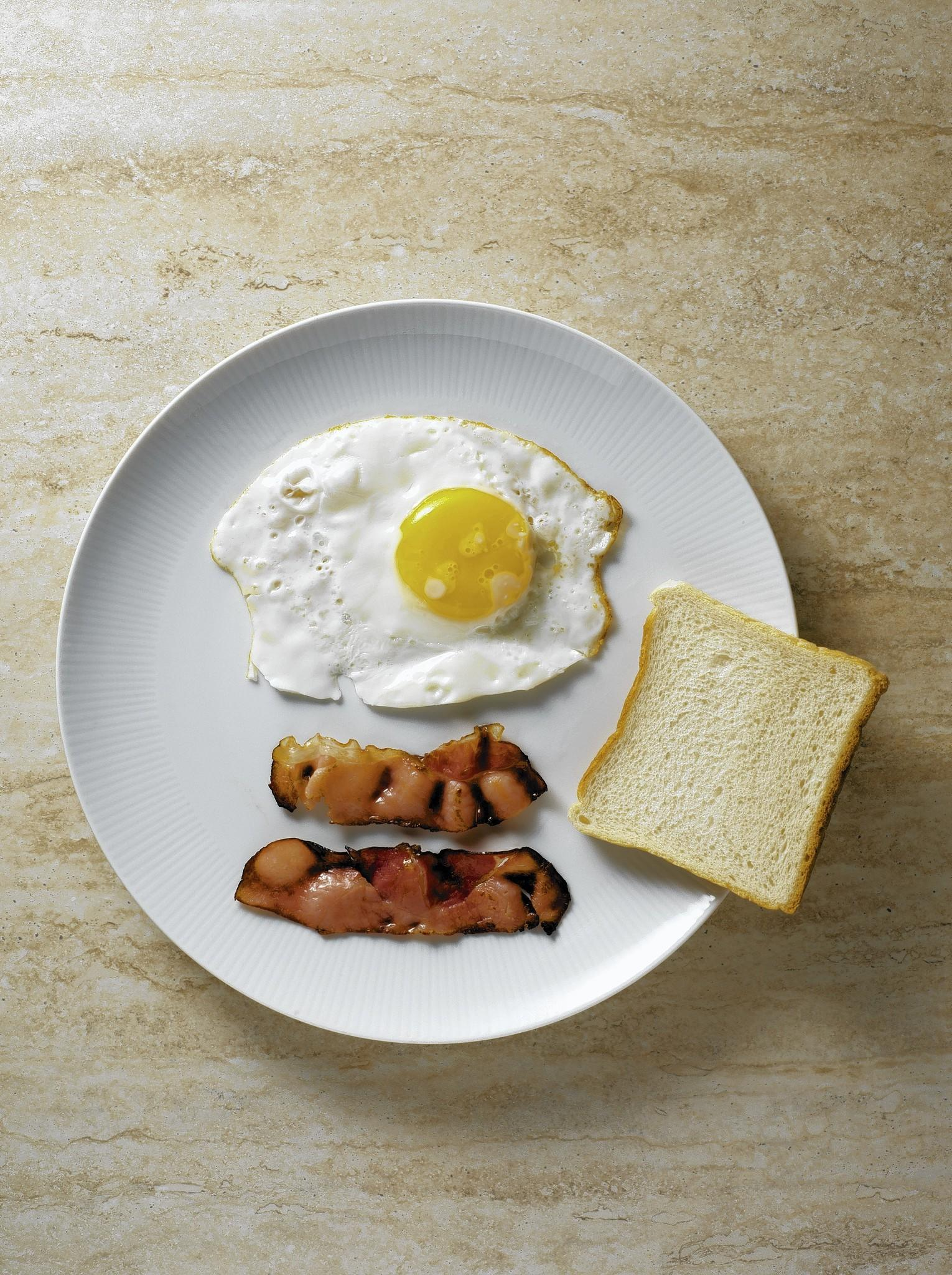 Although alternate-day dieters were eager for a typical bacon and eggs breakfast, they found they could only eat half of it.