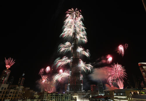 Fireworks explode from the Burj Khalifa, the world's tallest tower, in Dubai. Dubai kicked off New Year with a dazzling bid for a new world record to cap those the Gulf city state already holds for its mammoth property developments. The glittering fireworks display that lasted around six minutes spanned over 60 miles of the Dubai coast.