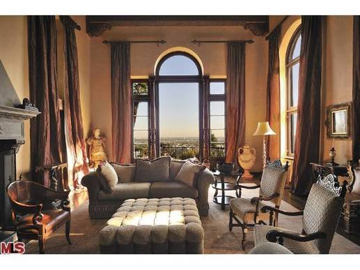 Arched windows in the two-story living room look out on the Los Angeles skyline.