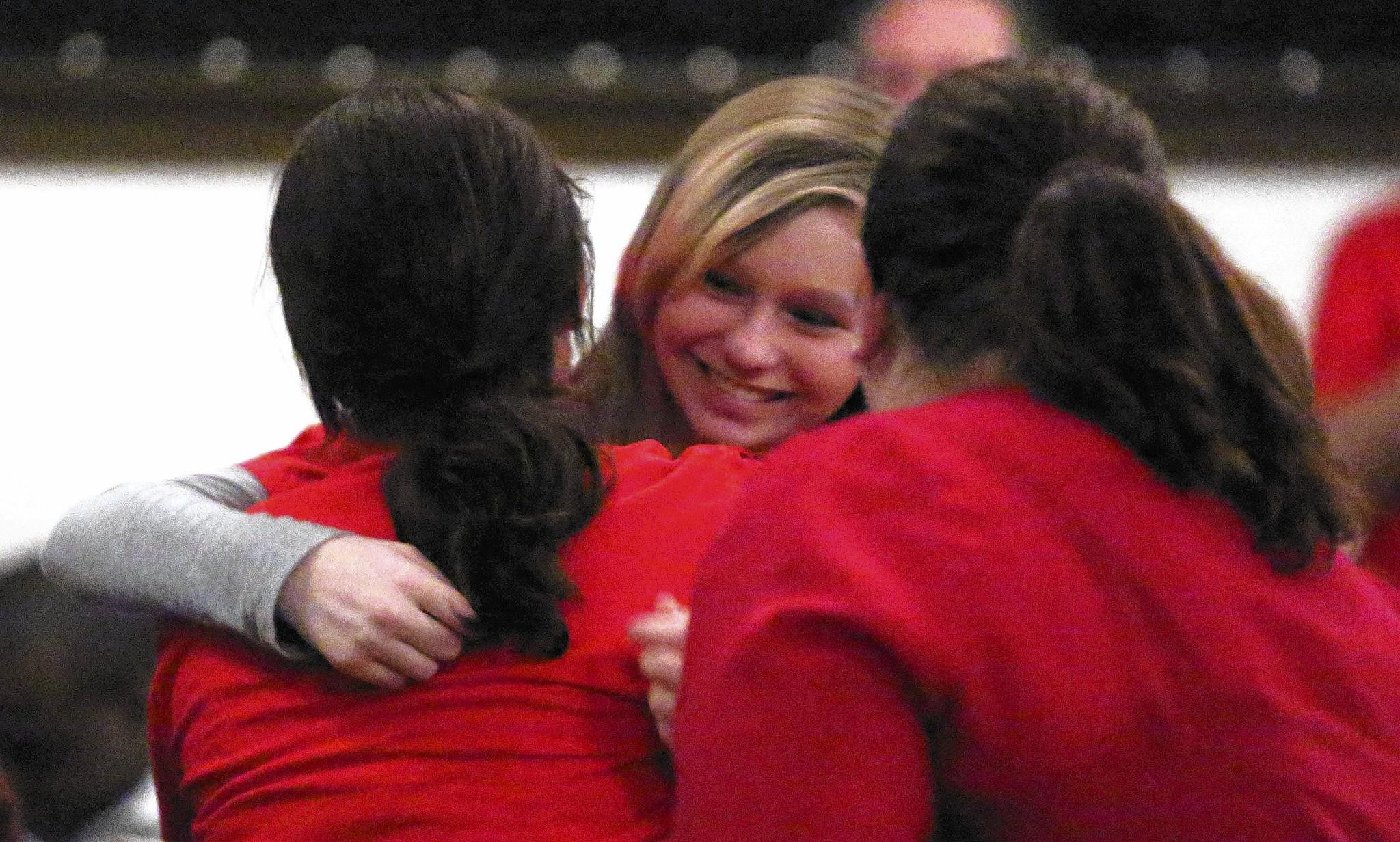 Bayli Silberstein, center, gets a hug in February after addressing the Lake County School Board about a proposed Gay-Straight Alliance club at Carver Middle School in Leesburg.