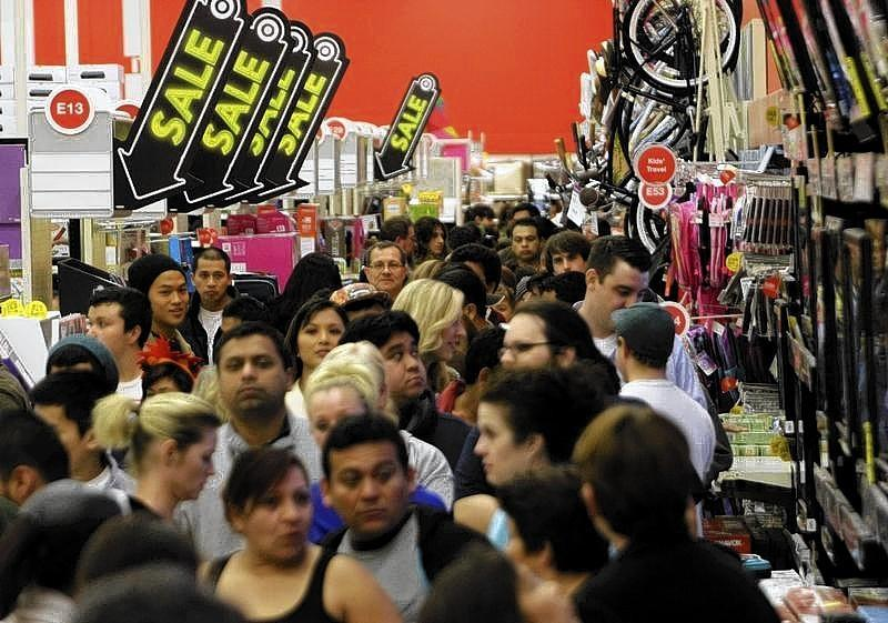 A crowd of shoppers browse at Target on the Thanksgiving Day holiday in Burbank, California.